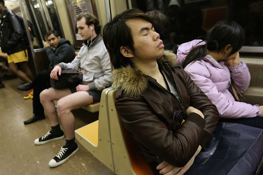 "NEW YORK, NY - JANUARY 13:  One subway passenger sleeps as others ride the train pantless on January 13, 2013 in New York City. Thousands of people participated in the 12th annual No Pants Subway Ride, organized by New York City prank collective Improv Everywhere. During the afternoon winter event, participants boarded separate subway stops and removed their pants, pretending that they did not know each other. The event, refered to as a ""celebration of silliness"" is designed to make fellow subway riders laugh and smile.  (Photo by John Moore/Getty Images) Photo: John Moore, Getty Images"