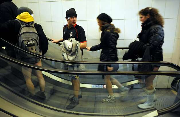 People take an escalator in underwear in the Sofia City subway as they take part in the 2013 No Pants Subway Ride on January 13, 2013 in the Bulgarian capital. The  No Pants Subway Ride, in its 12th year, still surprises passengers on public transit and is spreading to many cities across the globe.  AFP PHOTO / NIKOLAY DOYCHINOVNIKOLAY DOYCHINOV/AFP/Getty Images Photo: Nikolay Doychinov, AFP/Getty Images