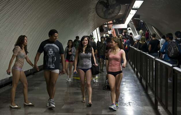 People walk through a subway station during the worldwide 'No Pants Subway Ride' event  in Mexico City on January 13, 2013. The 'No Pants Subway Ride', though in its 12th year, still surprises fellow passengers on public transit, and is spreading to other cities across the globe. AFP PHOTO/RONALDO SCHEMIDTRonaldo Schemidt/AFP/Getty Images Photo: Ronaldo Schemidt, AFP/Getty Images