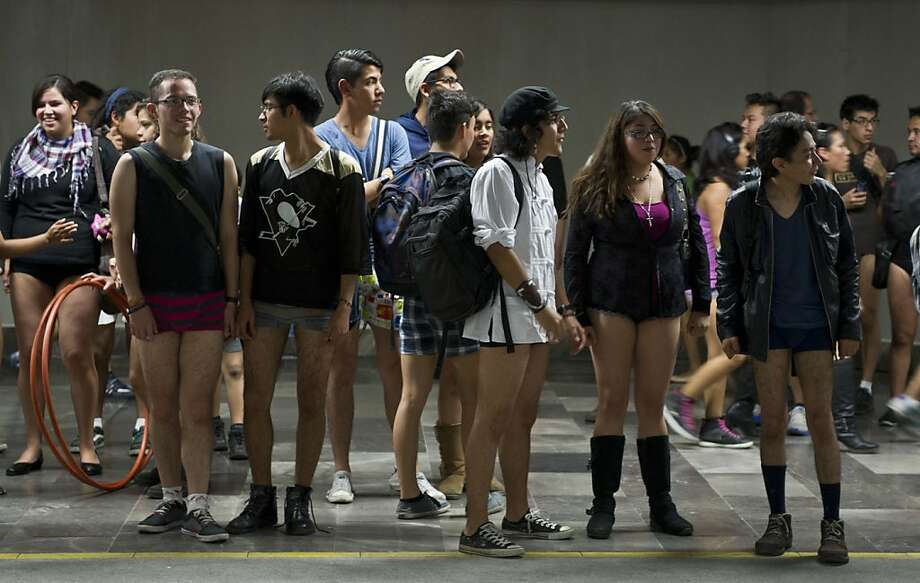People wait for the train at a subway station during the worldwide 'No Pants Subway Ride' event  in Mexico City on January 13, 2013. The 'No Pants Subway Ride', though in its 12th year, still surprises fellow passengers on public transit, and is spreading to other cities across the globe. AFP PHOTO/RONALDO SCHEMIDTRonaldo Schemidt/AFP/Getty Images Photo: Ronaldo Schemidt, AFP/Getty Images