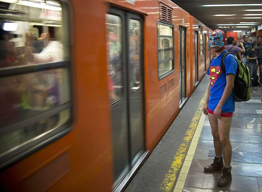 A young man waits to board a train at a subway station during the worldwide 'No Pants Subway Ride' event  in Mexico City on January 13, 2013. The 'No Pants Subway Ride', though in its 12th year, still surprises fellow passengers on public transit, and is spreading to other cities across the globe. AFP PHOTO/RONALDO SCHEMIDTRonaldo Schemidt/AFP/Getty Images Photo: Ronaldo Schemidt, AFP/Getty Images