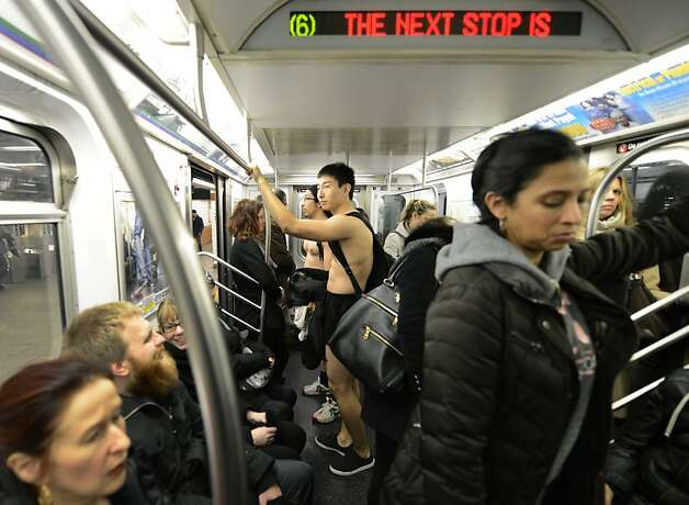 Some riders in the New York City subway in the underwear as the take part in the 2013 No Pants Subway Ride January 13, 2013. Started by Improv Everywhere, the goal is for riders to get on the subway train dressed in normal winter clothes (without pants) and keep a straight face.  AFP PHOTO / TIMOTHY A. CLARYTIMOTHY A. CLARY/AFP/Getty Images Photo: Timothy A. Clary, AFP/Getty Images