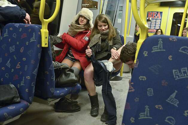 "Participants shed their clothes to take part in the annual 'No Pants Subway Ride' in Stockholm, Sunday, Jan. 13, 2013. The yearly prank, organized by New York City based prank collective ""Improv Everywhere"" was started in 2002, asking participants to ride subway lines trouser free and act straight faced about it. (AP Photo/Jan Erik Henriksson) SWEDEN OUT Photo: Janerik Henriksson, Associated Press"