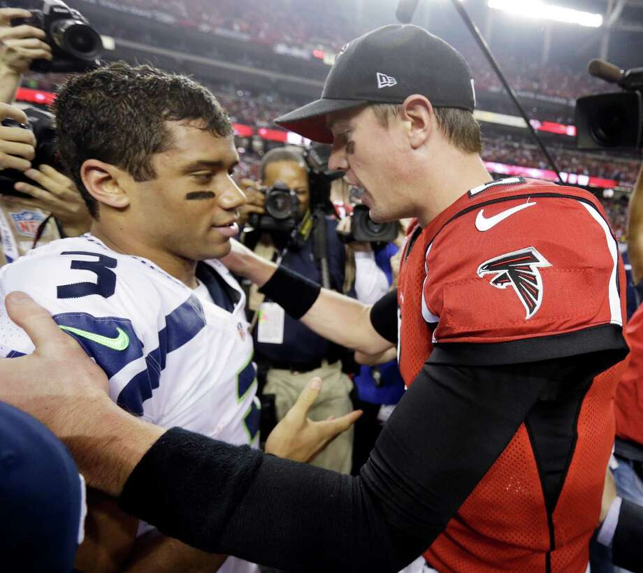 Atlanta Falcons quarterback Matt Ryan (2) speaks to Seattle Seahawks quarterback Russell Wilson (3) after the second half of an NFC divisional playoff NFL football game Sunday, Jan. 13, 2013, in Atlanta. The Falcons won 30-28. Photo: AP