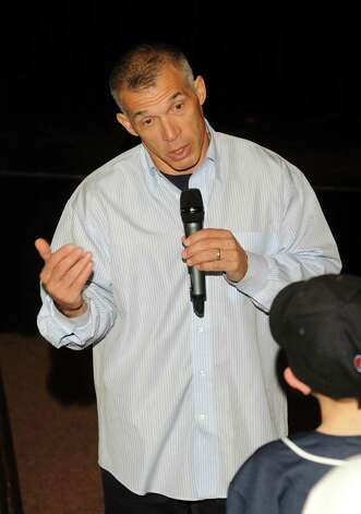 New York Yankees manager Joe Girardi answers a question asked by Shane Hauck, 11, of new Fairfield. Girardi was the guest speaker for a group of young baseball players during a meeting at New Fairfield High school on Sunday, Jan. 13, 2013. Photo: Lisa Weir / The News-Times Freelance
