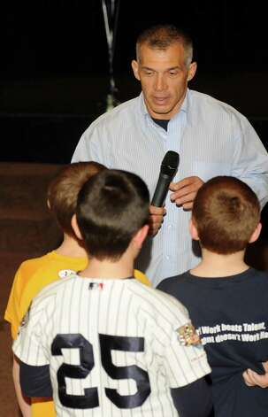 New York Yankees manager Joe Girardi talks to kids during a question and answer session for a small group of young baseball players that met at New Fairfield High school on Sunday, Jan. 13, 2013. Photo: Lisa Weir / The News-Times Freelance