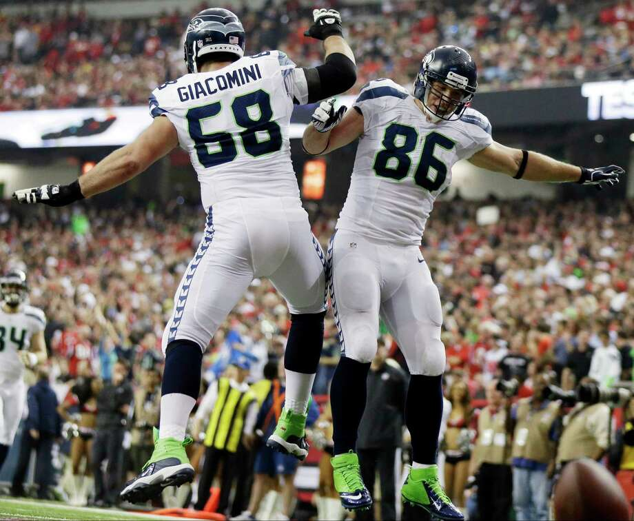 Seattle Seahawks tight end Zach Miller (86) celebrates with Breno Giacomini (68) after Miller scored a touchdown against the Atlanta Falcons during the second half of an NFC divisional playoff NFL football game Sunday, Jan. 13, 2013, in Atlanta. Photo: AP