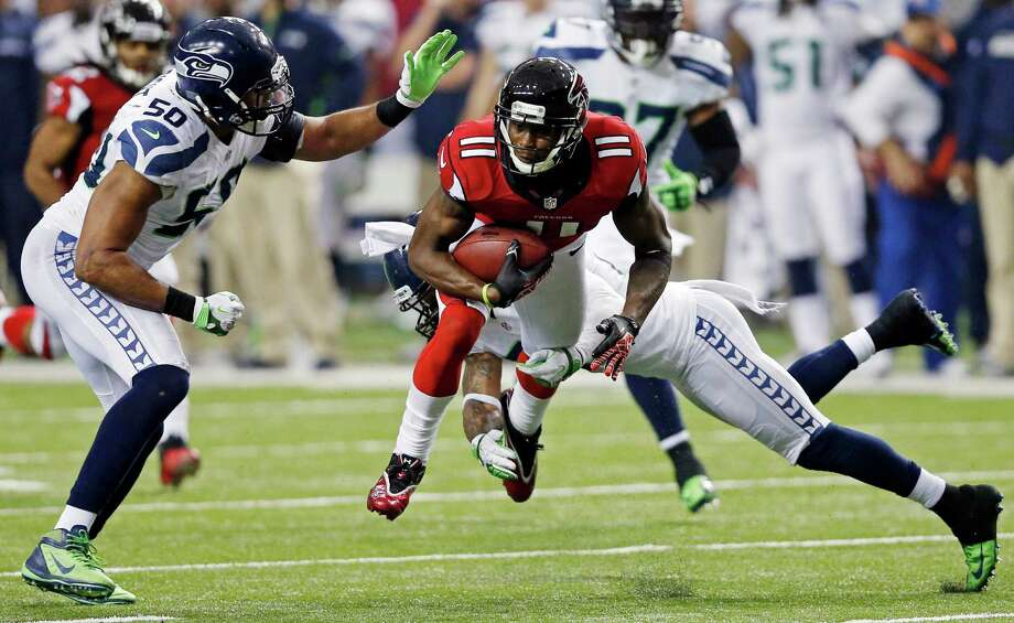 Atlanta Falcons wide receiver Julio Jones (11) works against Seattle Seahawks outside linebacker K.J. Wright (50) and free safety Earl Thomas (29) during the second half of an NFC divisional playoff NFL football game Sunday, Jan. 13, 2013, in Atlanta. Photo: AP