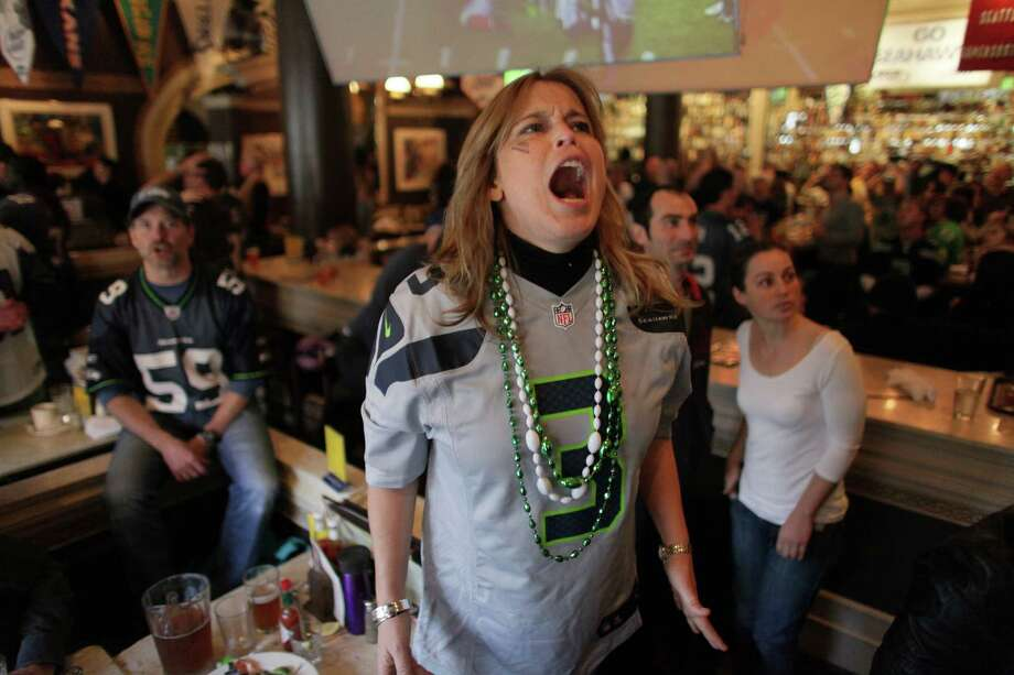 Helen Henry reacts as the Falcons make a field goal in final seconds during a game watching party at FX McRory's sports bar as the Seahawks play the Atlanta Falcons during an NFL playoff game in Atlanta on Sunday, January 13, 2013. The Hawks fell to the Falcons, ending their season. Photo: JOSHUA TRUJILLO, SEATTLEPI.COM / SEATTLEPI.COM