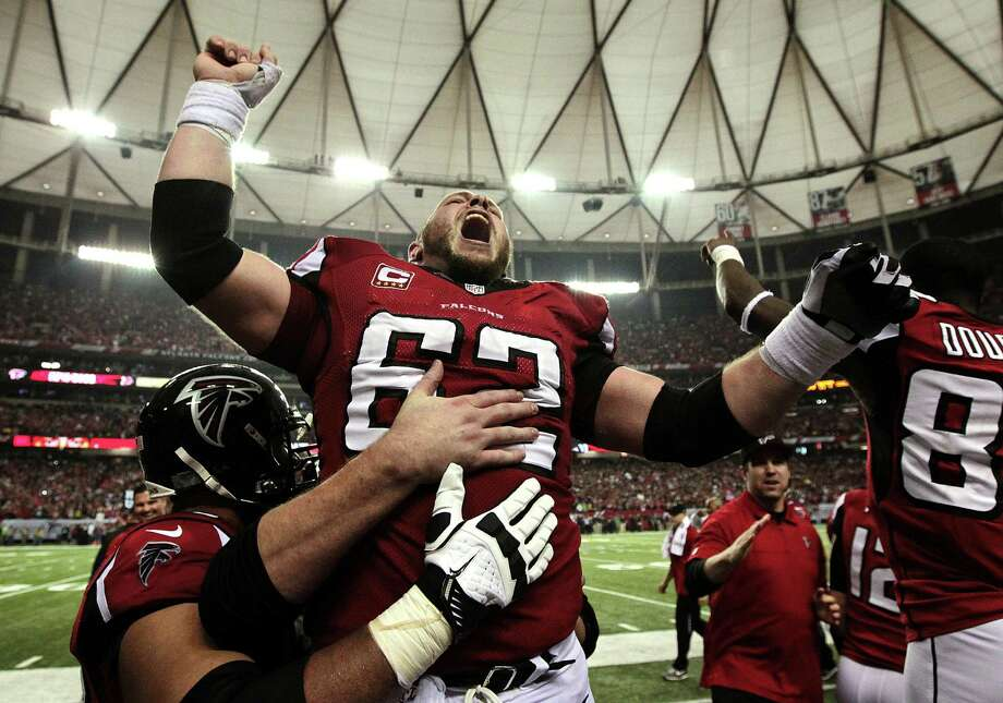Atlanta Falcons center Todd McClure (62) celebrates on the sidelines following kicker Matt Bryant's winning 49-yard field goal against the Seattle Seahawks during the fourth quarter of their NFC divisional playoff NFL football game, Sunday, Jan. 13, 2013, in Atlanta. The Falcons won 30-28. (AP Photo/Atlanta Journal-Constitution, Curtis Compton)  MARIETTA DAILY OUT; GWINNETT DAILY POST OUT; LOCAL TV OUT; WXIA-TV OUT; WGCL-TV OUT Photo: AP