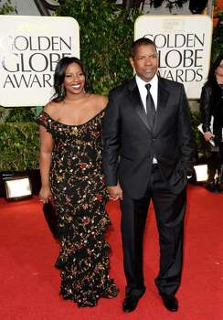 BEVERLY HILLS, CA - JANUARY 13:  Actor Denzel Washington (R) and Pauletta Washington arrive at the 70th Annual Golden Globe Awards held at The Beverly Hilton Hotel on January 13, 2013 in Beverly Hills, California. Photo: Jason Merritt, Getty Images / 2013 Getty Images