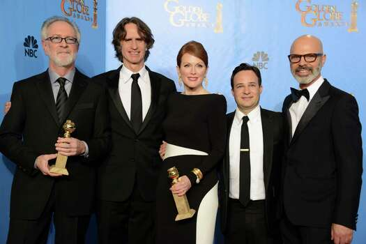 """Producer Gary Goetzman, from left, director Jay Roach, actress Julianne Moore, writer Danny Strong and producer Steve Shareshian pose with the award for for best miniseries or motion picture made for television for """"Game Change"""" backstage at the 70th Annual Golden Globe Awards at the Beverly Hilton Hotel on Sunday Jan. 13, 2013, in Beverly Hills, Calif. (Photo by Jordan Strauss/Invision/AP) Photo: Jordan Strauss, Associated Press / Invision"""