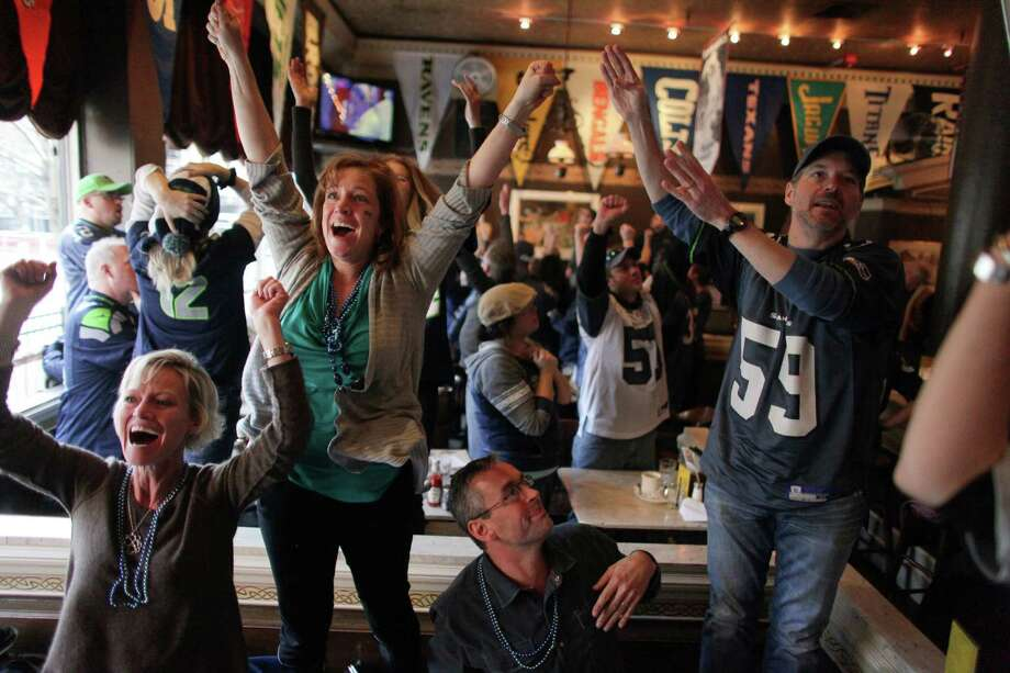 Fans watch the final play of the game during a watching party at FX McRory's sports bar as the Seahawks play the Atlanta Falcons during an NFL playoff game in Atlanta on Sunday, January 13, 2013. The Hawks fell to the Falcons, ending their season. Photo: JOSHUA TRUJILLO, SEATTLEPI.COM / SEATTLEPI.COM