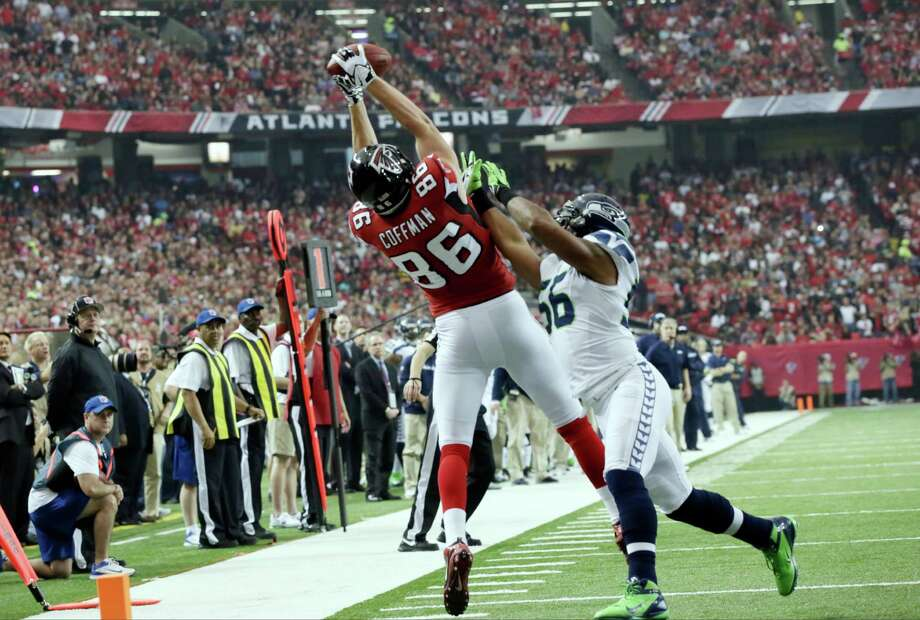 Atlanta Falcons' Chase Coffman catches a pass in front of Seattle Seahawks' Leroy Hill during the first half of an NFC divisional playoff NFL football game Sunday, Jan. 13, 2013, in Atlanta. Photo: AP