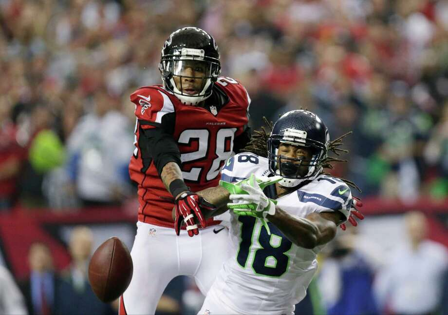 Atlanta Falcons free safety Thomas DeCoud (28) breaks up a play in back of Seattle Seahawks wide receiver Sidney Rice (18) during the second half of an NFC divisional playoff NFL football game Sunday, Jan. 13, 2013, in Atlanta. The Falcons won 30-28. Photo: AP