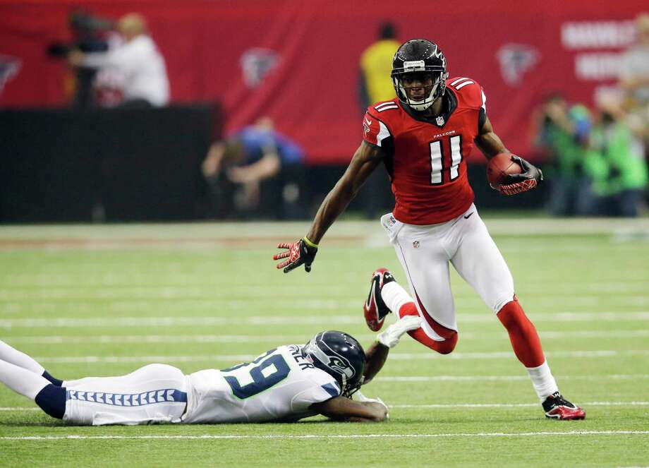 Atlanta Falcons wide receiver Julio Jones (11) runs after a catch during the first half of an NFC divisional playoff NFL football game against the Seattle Seahawks Sunday, Jan. 13, 2013, in Atlanta. Photo: AP