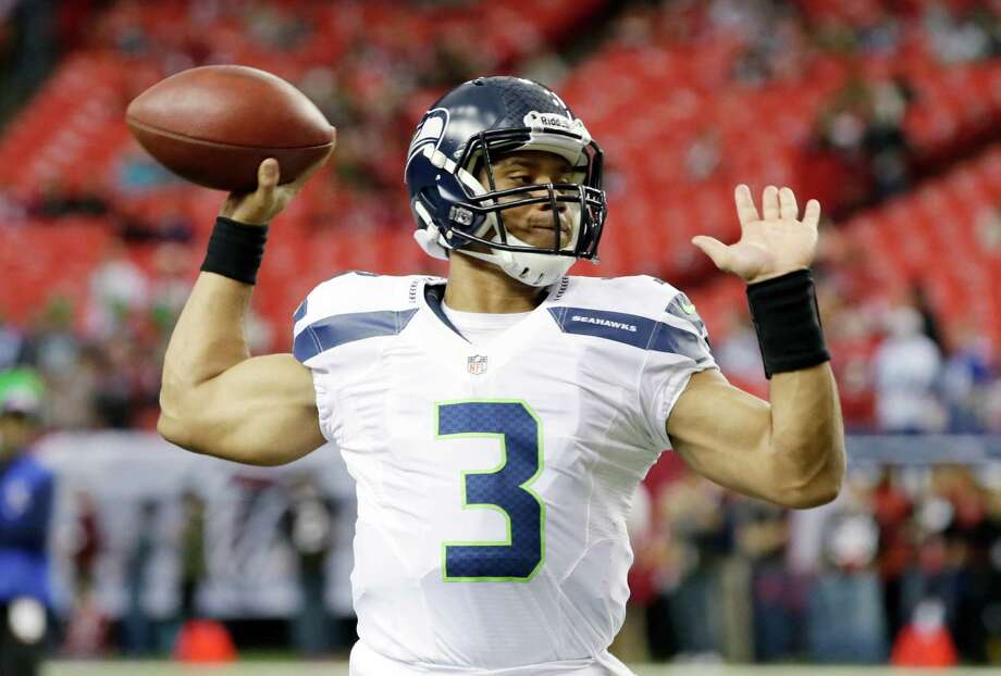 Seattle Seahawks quarterback Russell Wilson warms up before the first half of an NFC divisional playoff NFL football game against the Atlanta Falcons Sunday, Jan. 13, 2013, in Atlanta. Photo: AP
