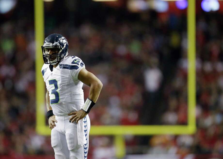 Seattle Seahawks quarterback Russell Wilson (3) watches play against the Atlanta Falcons during the second half of an NFC divisional playoff NFL football game Sunday, Jan. 13, 2013, in Atlanta. Photo: AP