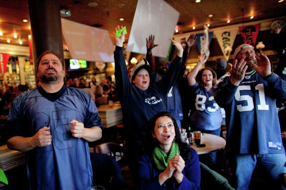 Fans react during a game watching party at FX McRory's sports bar as the Seahawks play the Atlanta Falcons during an NFL playoff game in Atlanta on Sunday, January 13, 2013. The Hawks fell to the Falcons, ending their season. Photo: JOSHUA TRUJILLO, SEATTLEPI.COM / SEATTLEPI.COM