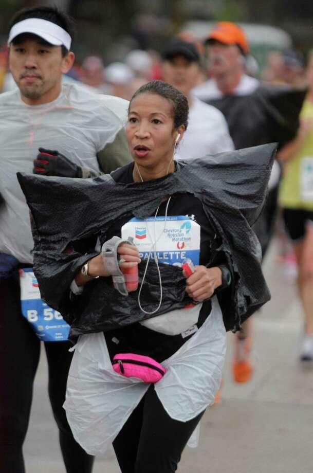 Paulette Moore runs along Studewood near White Oak during the Chevron Houston Marathon and Aramco Houston Half Marathon Sunday, Jan. 13, 2013, in Houston. Photo: Melissa Phillip, Houston Chronicle / © 2013 Houston Chronicle