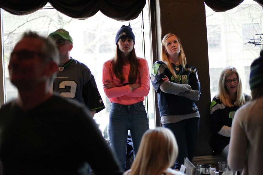 Fans react during a game watching party at FX McRory's sports bar as the Seahawks play the Atlanta F
