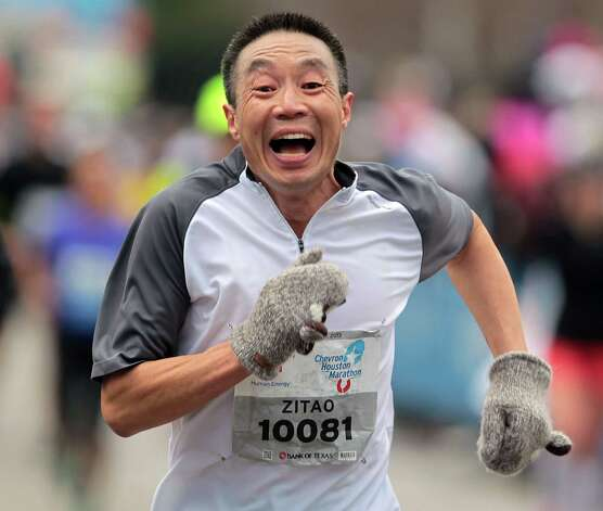 Zitao Xu nears the finish line during the Chevron Houston Marathon Sunday, Jan. 13, 2013, in Houston. Photo: James Nielsen, Chronicle / © Houston Chronicle 2013