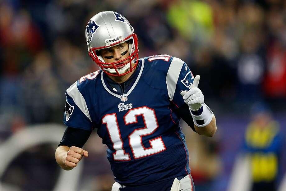 New England quarterback Tom Brady had three touchdown passes in his 17th postseason win. Photo: Jim Rogash, Getty Images