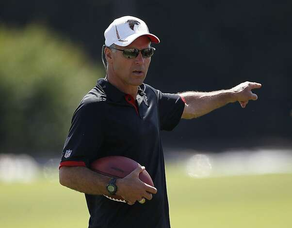 FILE - This July 27, 2012 file photo shows Atlanta Falcons defensive coordinator Mike Nolan during football training camp in Flowery Branch, Ga. In their first year with the Atlanta Falcons, defensive coordinator Nolan and offensive coordinator Dirk Koetter helped energize the entire roster by putting star players in position to succeed and by giving all the reserves a chance to contribute. The formula has worked thus far, but Nolan and Koetter know their entire body of work this season will be judged on how well Atlanta performs in the playoffs. (AP Photo/John Bazemore, File) Photo: John Bazemore, Associated Press