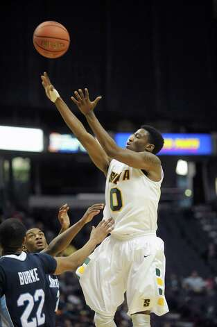 Siena's Rich Audu, right, puts up a shot over Saint Peter's players during their game at the Times Union Center on Sunday, Jan. 13, 2013 in Albany, NY. (Paul Buckowski / Times Union) Photo: Paul Buckowski  / 00020599D