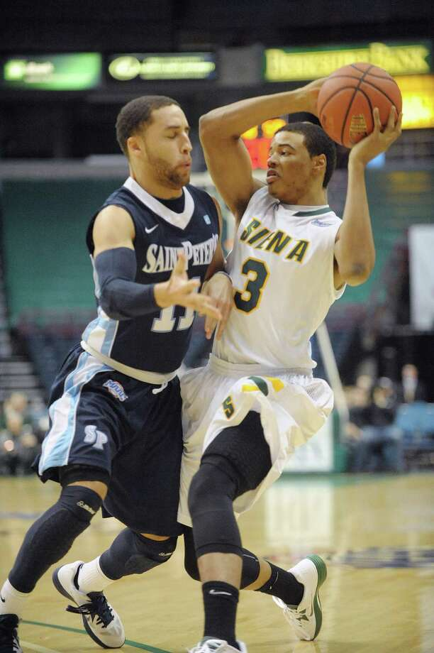Saint Peter's Desi Washington, left, tries to steal the ball from Siena's Ryan Oliver during their game at the Times Union Center on Sunday, Jan. 13, 2013 in Albany, NY.  (Paul Buckowski / Times Union) Photo: Paul Buckowski  / 00020599D