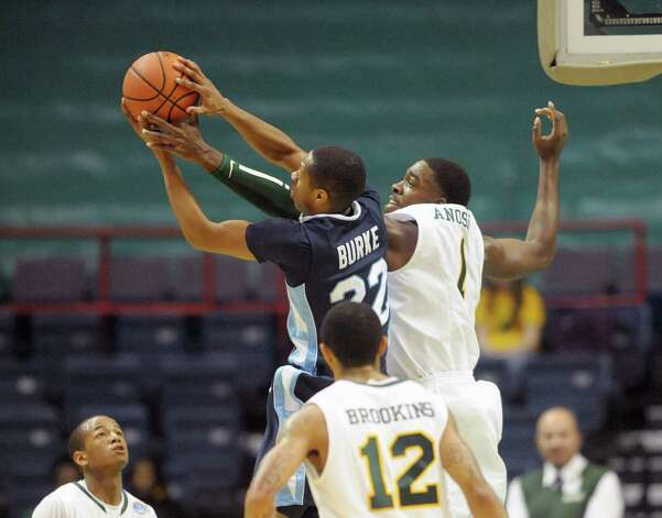 Saint Peter's Chris Burke, left, and Siena's O.D. Anosike battle for a rebound during their game at the Times Union Center on Sunday, Jan. 13, 2013 in Albany, NY.  (Paul Buckowski / Times Union) Photo: Paul Buckowski  / 00020599D