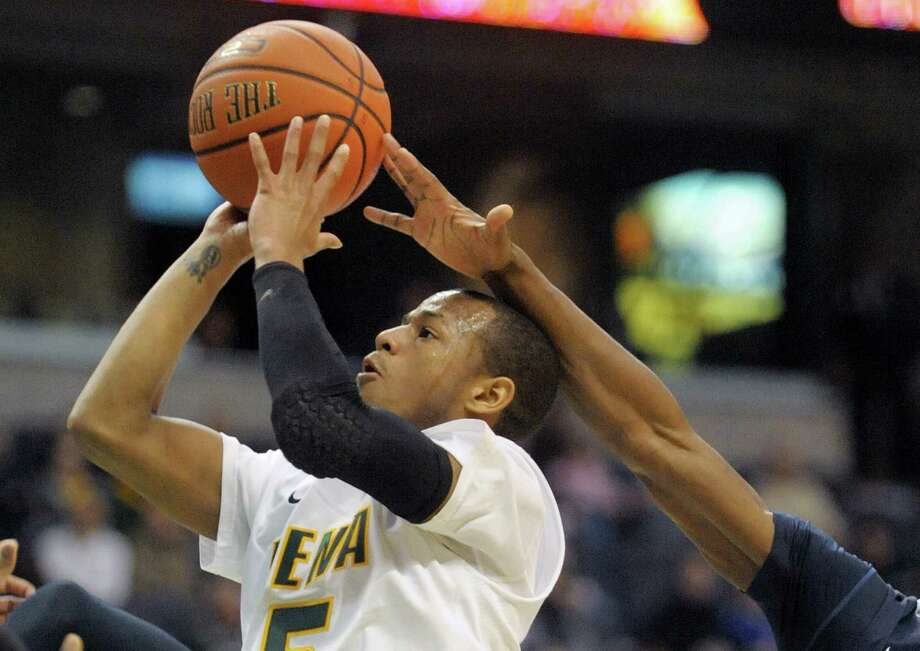 Siena's Evan Hymes puts up a shot before a  Saint Peter's player can block the shot during their game at the Times Union Center on Sunday, Jan. 13, 2013 in Albany, NY.   (Paul Buckowski / Times Union) Photo: Paul Buckowski / 00020599D
