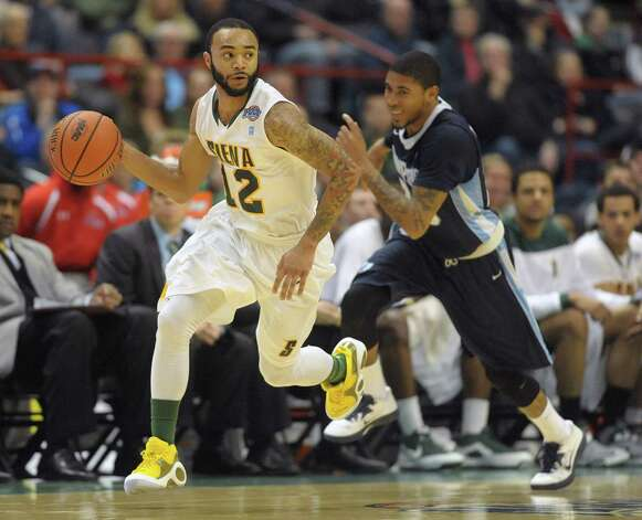 Siena's Rakeem Brookins, left, brings the ball up the court past Saint Peter's players during their game at the Times Union Center on Sunday, Jan. 13, 2013 in Albany, NY.   (Paul Buckowski / Times Union) Photo: Paul Buckowski / 00020599D