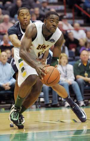 Siena's O.D. Anosike moves around a Saint Peter's player on his way to the basket during their game at the Times Union Center on Sunday, Jan. 13, 2013 in Albany, NY.  (Paul Buckowski / Times Union) Photo: Paul Buckowski  / 00020599D