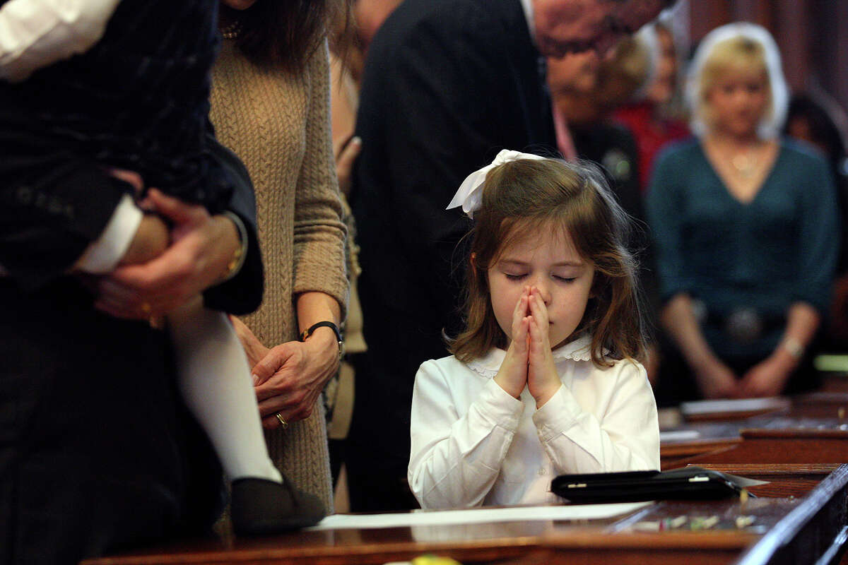 Helen Taylor, 6, daughter of Rep. Van Tylor, R-Plano, prays during the invocation at the start of the 83rd Texas Legislature at the State Capitol in Austin, Tuesday, Jan. 8, 2013.