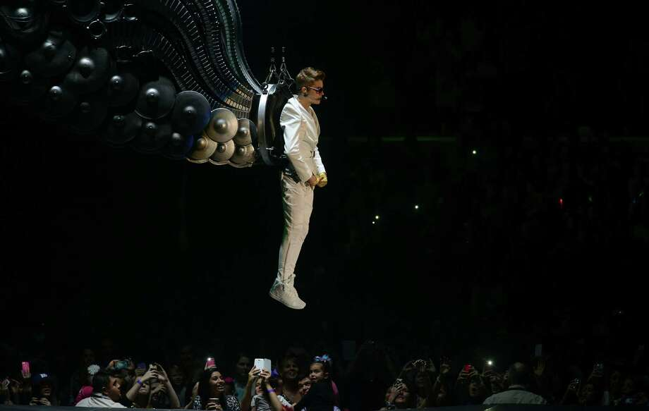 "Justin Bieber descends on wings for his ""Believe"" tour performance at the AT&T Center on Saturday night, Jan. 12, 2013. Photo: Billy Calzada, San Antonio Express-News / SAN ANTONIO EXPRESS-NEWS"