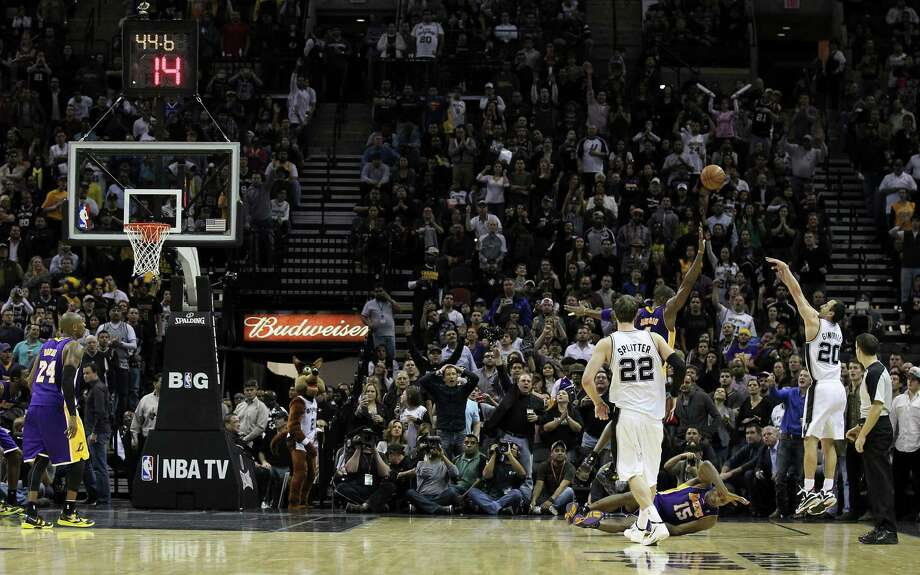 Spurs' Manu Ginobili (20) shoots a three-pointer late in the fourth over Los Angeles Lakers' Kobe Bryant (24) in the second half at the AT&T Center on Wednesday, Jan. 9, 2013. Spurs defeated the Lakers, 108-105. Photo: Kin Man Hui, San Antonio Express-News / © 2012 San Antonio Express-News