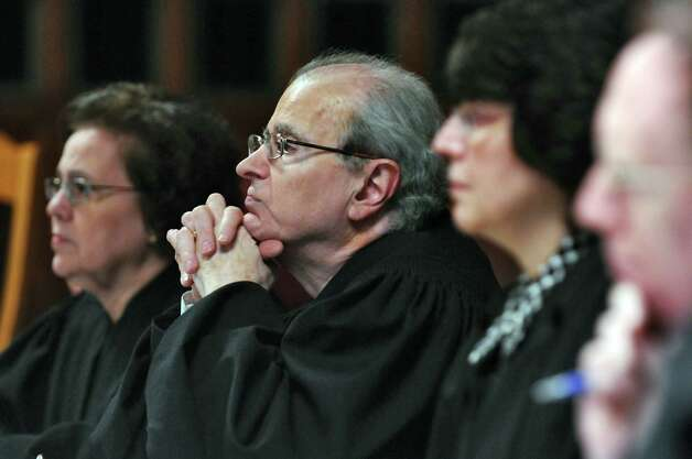 New York State Court of Appeals Chief Judge Jonathan Lippman, second from left, listens to a lawyer during a petition by representatives of the Democratic Senate minority to challenge the constitutional validity of legislation reapportioning State Senate districts based on the 2010 federal census, which increases the size of the Senate from 62 seats to 63, on Thursday April 26, 2012 in Albany, NY.  Now-retired Judge Caren Beauchamp Ciparick is on the left.  (Philip Kamrass / Times Union ) Photo: Philip Kamrass / 10017449A