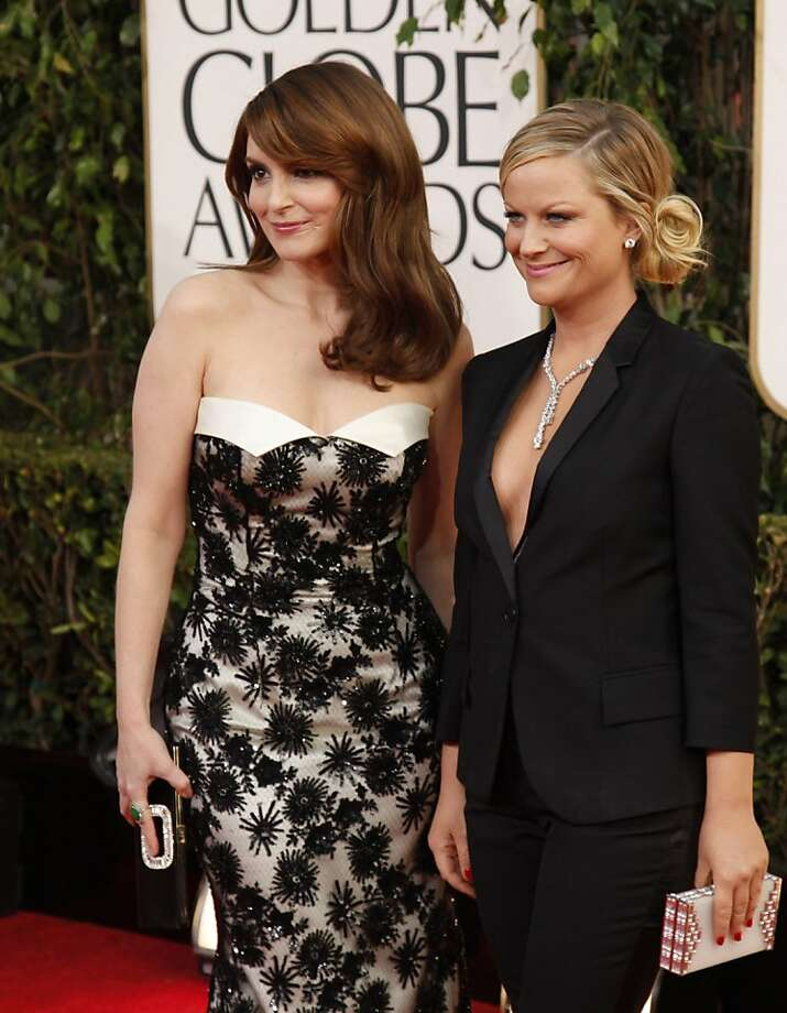 Tina Fey, left, and Amy Poehler arrive for the 70th Annual Golden Globe Awards show at the Beverly Hilton Hotel on Sunday, January 13, 2013, in Beverly Hills, California. (Kirk McKoy/Los Angeles Times/MCT) Photo: Kirk McKoy, McClatchy-Tribune News Service