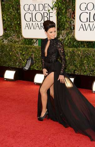 With her hair upswept, Eva Longoria dazzles by revealing ample leg through a lace Pucci dress. Photo: Jason Merritt, Getty Images