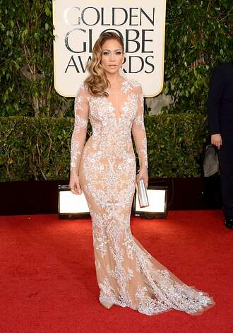 Red-carpet mainstay Jennifer Lopez, her curls cascading, offers glimpses of skin in a Zuhair Murad gown. Photo: Jason Merritt, Getty Images