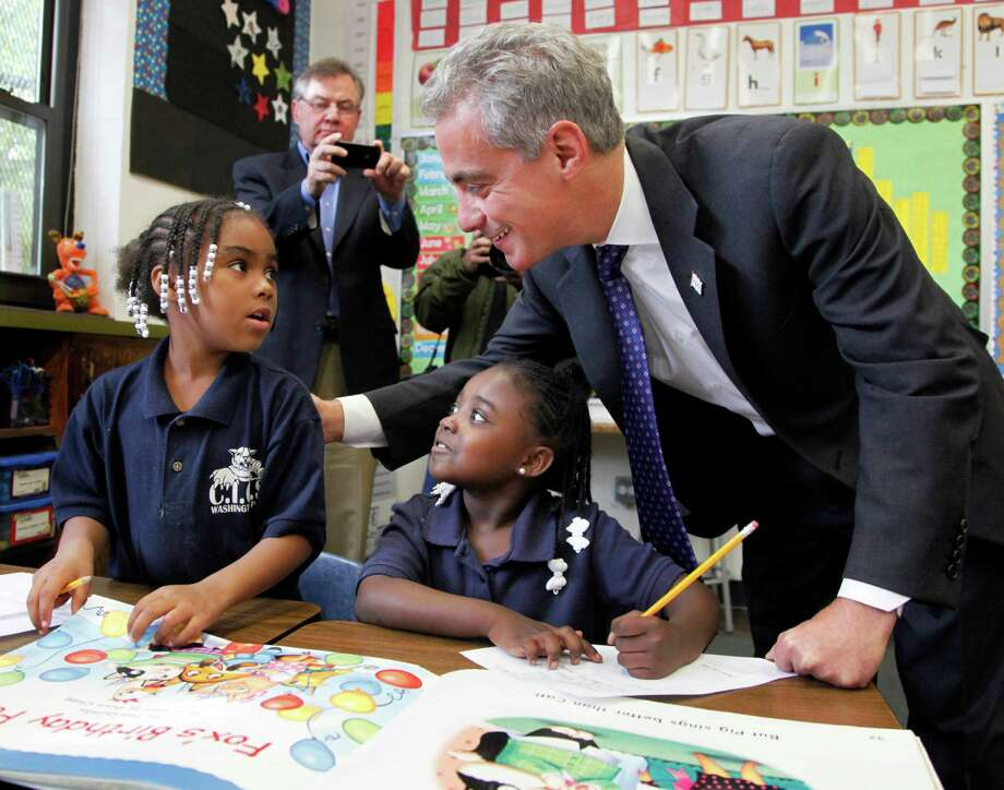 Chicago Mayor Rahm Emanuel  visits the CICS Washington Park School on Chicago's South Side in October 2011. The Chicago Public Schools extended the school day from 5 hours and 45 minutes to 7 hours in 2012 after a heated offensive by parents. Emanuel had originally proposed a 7½-hour school day. Photo: Charles Rex Arbogast, STF / AP
