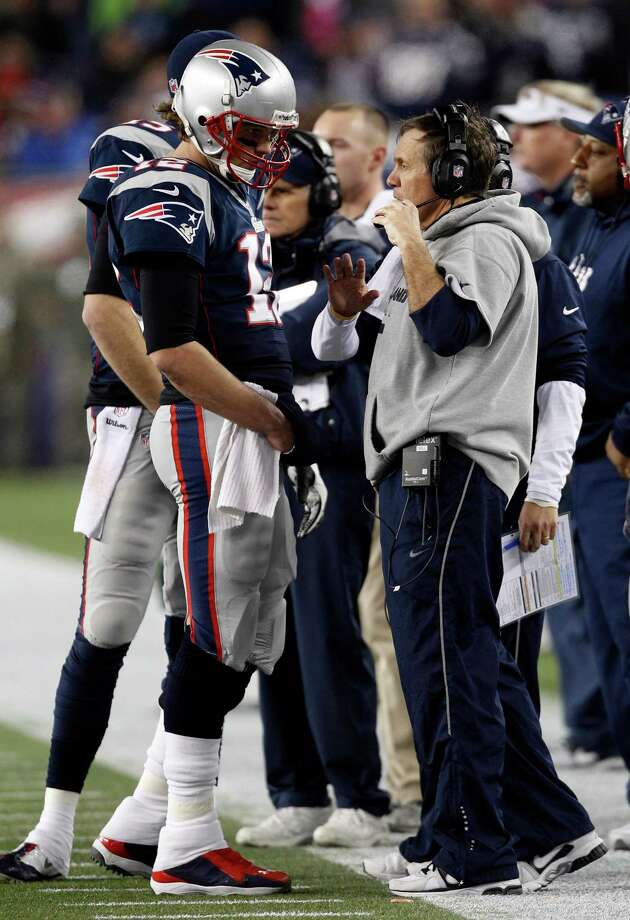 New England Patriots quarterback Tom Brady, left, talks with head coach Bill Belichick during the second half of an AFC divisional playoff NFL football game against the Houston Texans in Foxborough, Mass., Sunday, Jan. 13, 2013. The Patriots defeated the Texans 41-28. (AP Photo/Stephan Savoia) Photo: Stephan Savoia, Associated Press / AP