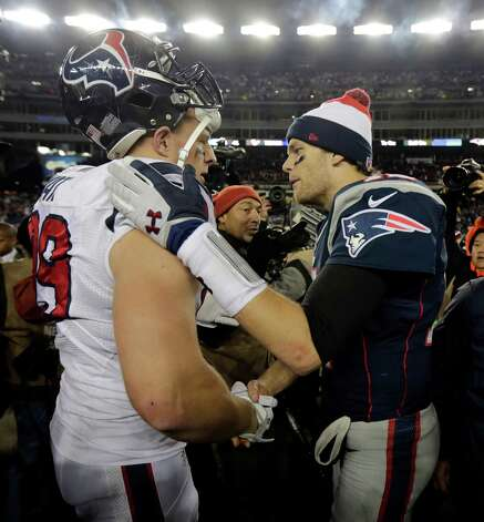 New England Patriots quarterback Tom Brady, right, talks with Houston Texans defensive end J.J. Watt following their AFC divisional playoff NFL football game in Foxborough, Mass., Sunday, Jan. 13, 2013. The Patriots defeated the Texans 41-28. (AP Photo/Charles Krupa) Photo: Charles Krupa, Associated Press / AP