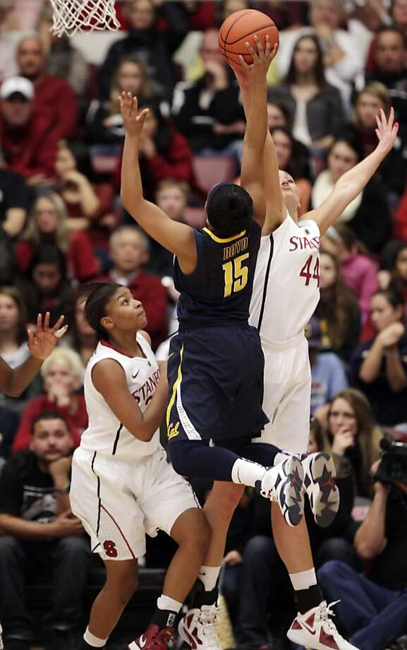 Cal's Brittany Boyd puts up a shot over Stanford's Amber Orange, left, and Joslyn Tinkle, right, in the second half. Stanford women played Cal at Maples Pavilion in Stanford, Calif., on Sunday, January 13, 2013, with Cal defeating the Cardinal 67-54 Photo: Carlos Avila Gonzalez, The Chronicle