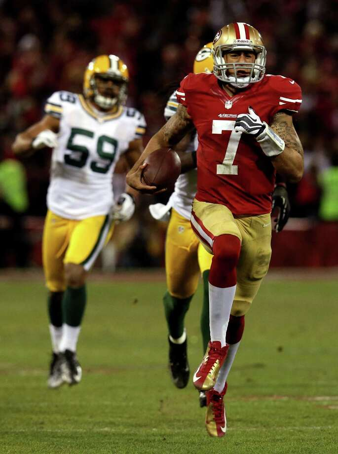 Colin Kaepernick's 181 yards rushing were the most by a quarterback in playoff history. Photo: Stephen Dunn, Staff / 2013 Getty Images