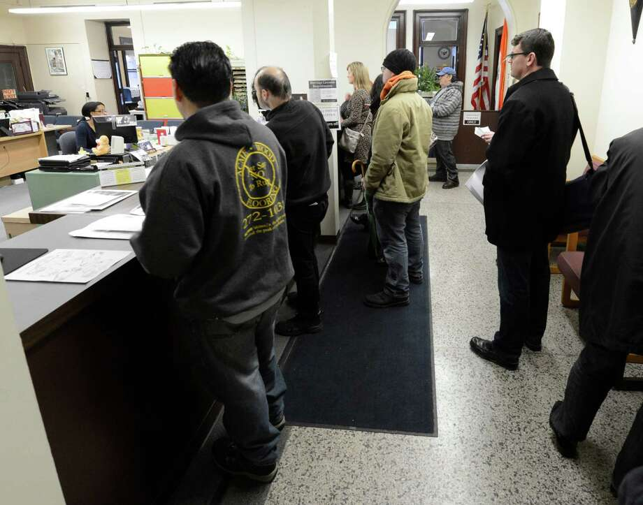 People stand in line to get their neighborhood parking permits in Albany City Hall Jan. 11, 2013 in Albany, N.Y.     (Skip Dickstein/Times Union) Photo: SKIP DICKSTEIN