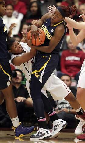 Cal's Gennifer Brandon grabs a rebound from Stanford's Amber Orrange in the second half. Stanford women played Cal at Maples Pavilion in Stanford, Calif., on Sunday, January 13, 2013, with Cal defeating the Cardinal 67-54 Photo: Carlos Avila Gonzalez, The Chronicle