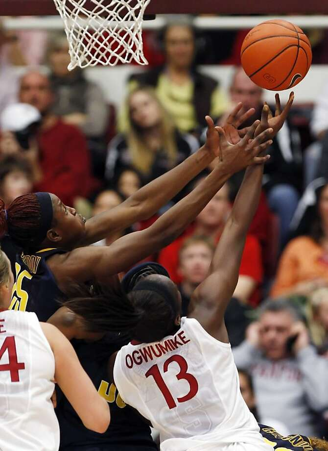Chiney Ogwumike, right, reaches for a rebound against Cal's Gennifer Brandon, left, in the second half. Stanford women played Cal at Maples Pavilion in Stanford, Calif., on Sunday, January 13, 2013, with Cal defeating the Cardinal 67-54 Photo: Carlos Avila Gonzalez, The Chronicle
