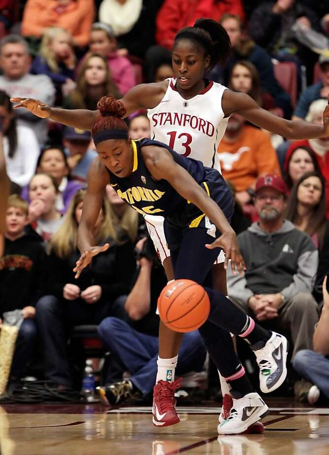Cal's Gennifer Brandon, front, reaches for a loose ball in front of Stanford's Chiney Ogwumike in the second half. Stanford women played Cal at Maples Pavilion in Stanford, Calif., on Sunday, January 13, 2013, with Cal defeating the Cardinal 67-54 Photo: Carlos Avila Gonzalez, The Chronicle